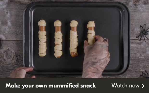 Make your own mummified snack. Click to watch the video that shows you how to make dough wrapped hot dogs that look like mummies.