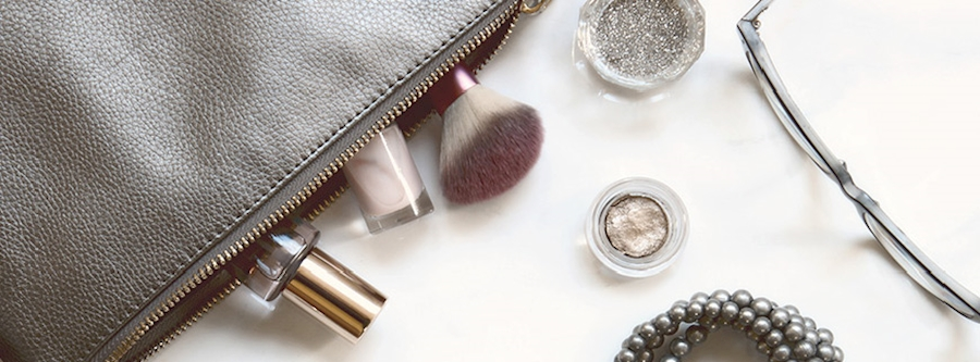 Cosmetics bag with products peaking out